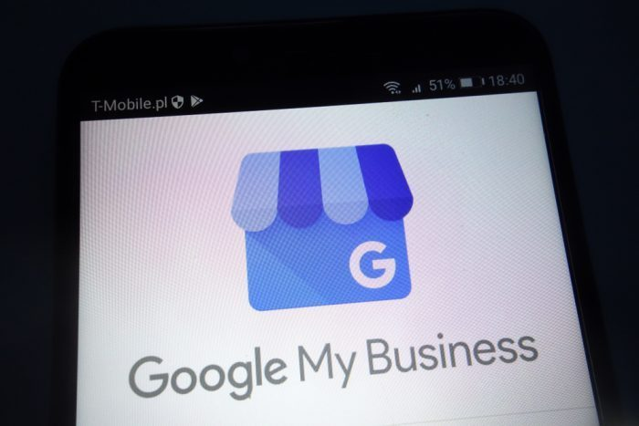 Google My Business text on a phone screen