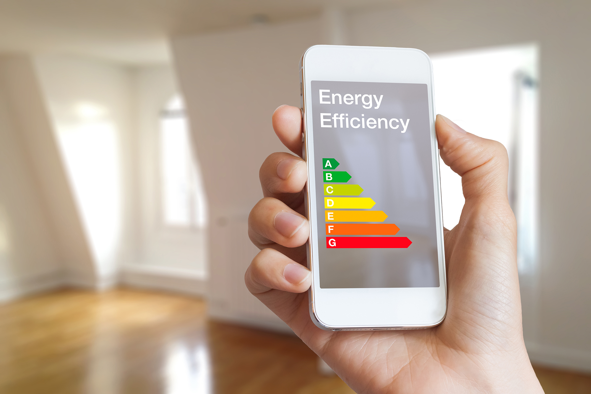 Energy efficiency rating on smartphone app, home interior in bac